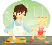 Family cooking. Mother and her daughter cooking Royalty Free Stock Photos