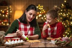 Family cooking Christmas cookies. stock photos