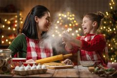 Family cooking Christmas cookies. royalty free stock photos