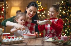 Family cooking Christmas cookies stock photography