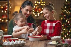 Family cooking Christmas cookies royalty free stock image