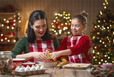 Family cooking Christmas cookies stock image