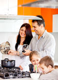 Family cooking dinner Stock Image