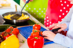 Family cooking in domestic kitchen healthy food Royalty Free Stock Photography