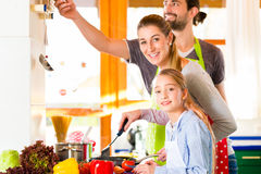 Family cooking in domestic kitchen healthy food Stock Images