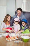 Family cooking food in kitchen Stock Image