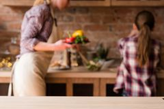 Family cooking food preparation home kitchen space. Family cooking. food preparation and home kitchen workspace. mother and daughter in blurred background royalty free stock photography