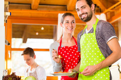 Family cooking healthy food in domestic kitchen Stock Photo