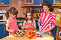 Family cooking at home Stock Photos