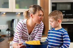 Family cooking in kitchen Stock Photos