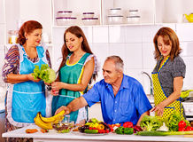 Family cooking at kitchen. Big family cooking at kitchen. Grandfather and grandmother. Women cooking at home royalty free stock photos