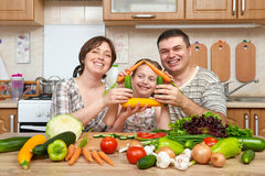 Family cooking in kitchen interior at home, fresh fruits and vegetables. Healthy food concept. Woman, man and children. Making hou Royalty Free Stock Photography