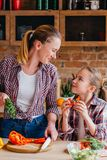 Family cooking loving relationship food health. Family cooking. Mother and daughter loving relationship. Food preparation and healthy lifestyle. Making vegetable stock photo