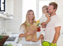 Family cooking in a modern kitchen setting Stock Images