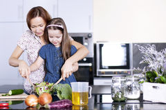 Family Cooking. Mother with little daughter Stock Photos