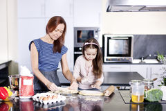Family Cooking. Mother with little daughter Royalty Free Stock Photos