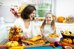 Family cooking pumpkin soup for Halloween lunch royalty free stock image