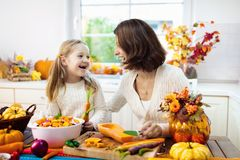 Family cooking pumpkin soup for Halloween lunch royalty free stock photography