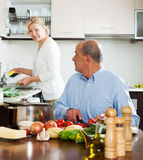 Family cooking salad at home Royalty Free Stock Image