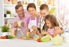Family cooking salad Stock Photography