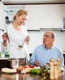 Family cooking Spaniard tomatoes at home Stock Photos