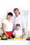 Family cooking together stock photos