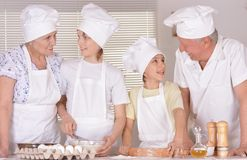 Family cooking together. An elderly couple and their grandson knead the dough for the pie together Stock Photo