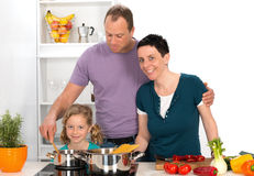Family is cooking together Stock Photo