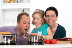 Family is cooking together. Happy family is cooking together royalty free stock images