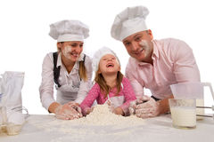 Family cooking together isolated on white. royalty free stock photos