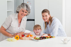 Family cooking together in the kitchen Royalty Free Stock Image