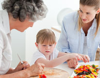 Family cooking together in the kitchen Royalty Free Stock Photography