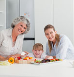Family cooking together in the kitchen Royalty Free Stock Images
