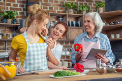 Family cooking together in kitchen stock images