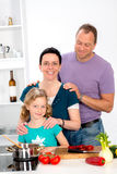 Family is cooking together. Family with one daughter is cooking together royalty free stock photos