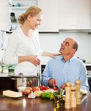 Family cooking vegetables at home Stock Photography