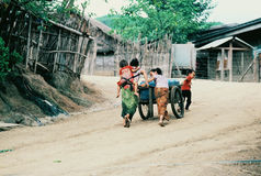 Family cooperation. A Hmong family transports their rationed water, Ban Vinai refugee camp, Loei, Thailand,  1984 Royalty Free Stock Image