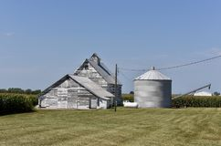 Family Corn Farm. This is a Summer picture of the equipment buildings and corn silo on a family corn farm located in Coles County, Illinois.  This picture was Royalty Free Stock Image