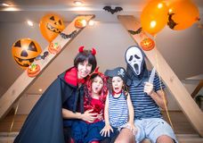 Family in halloween costumes stock photos