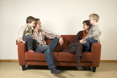 Family On A Couch 1 Royalty Free Stock Photos