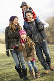 Family on country walk in winter Stock Photo