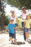 Family On Countryside Walk Together Stock Photos