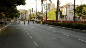 Family couple biking on car-less city street stock video