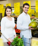 Family couple buying fresh vegetables in market Stock Photography