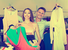 Family couple is choosing new dresses Royalty Free Stock Photo