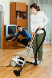 Family  couple doing housework together in home Royalty Free Stock Photography