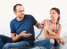 Family couple having serious conversation Stock Photo