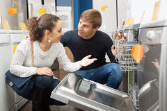 Family couple at household appliances store. Portrait of happy family couple at household appliances store stock image
