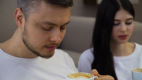 Family couple leisure communication drinking tea. Family couple leisure. communication. relaxing time. man and woman drinking coffee or cappuccino at home stock footage