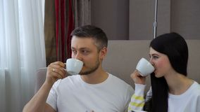 Family couple leisure communication drinking tea. Family couple leisure. communication. relaxing time. man and woman drinking tea or coffee at home stock footage